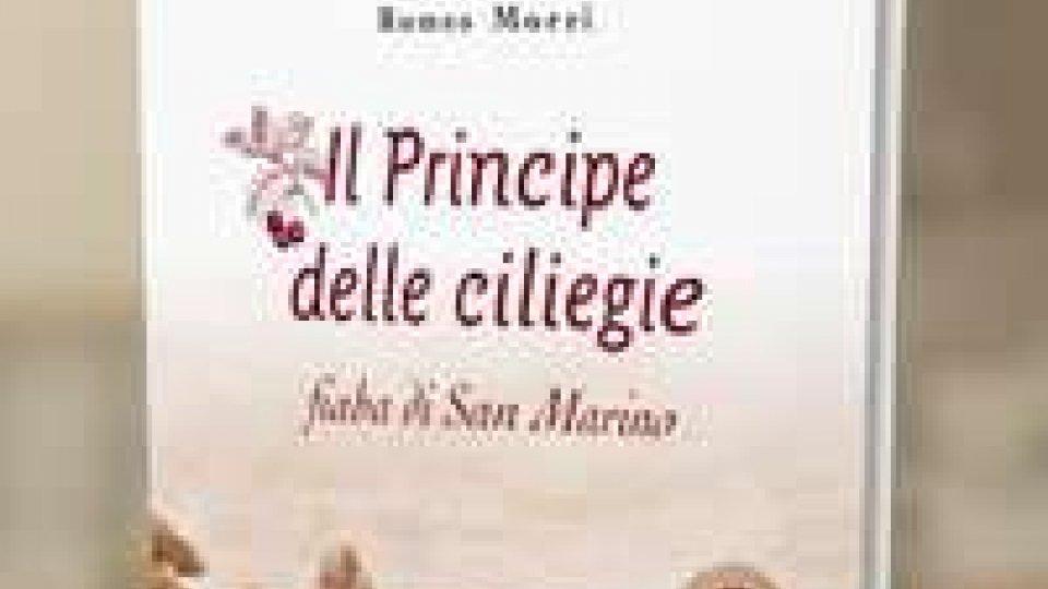 Asset Banca: distribuito agli alunni delle scuole elementari 'Il Principe delle Ciliegie' di Romeo Morri