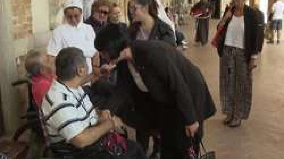 I Capitani Reggenti con i malatiVisita della Reggenza al Santuario di Loreto in occasione del pellegrinaggio USTAL-UNITALSI
