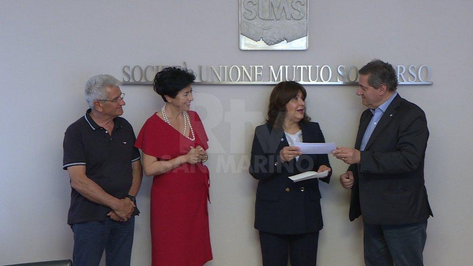 Il contributo raccolto con il Concerto di Natale donato all'Asdos