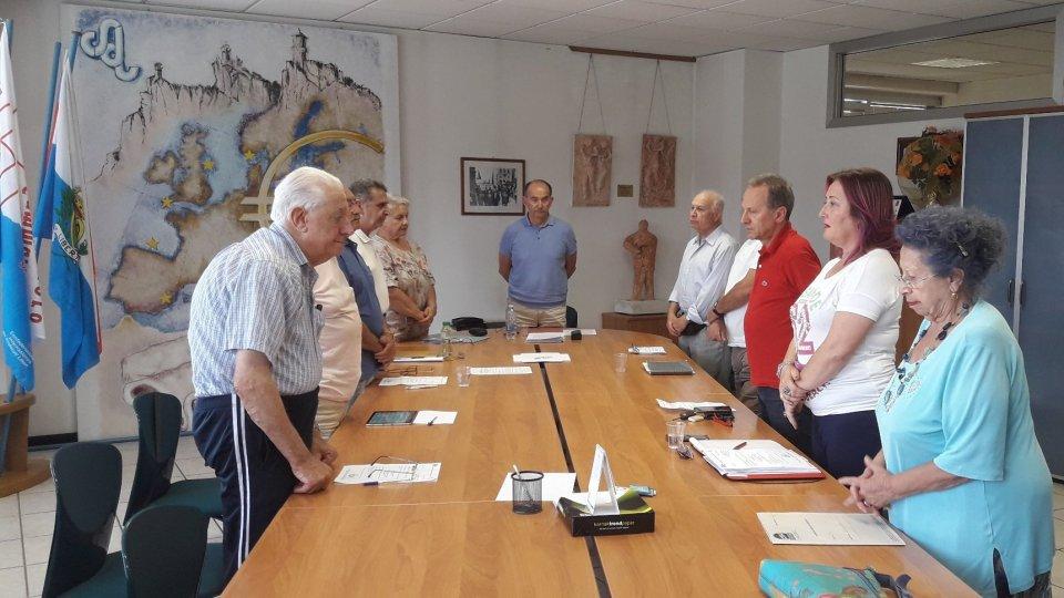 Nella foto, il Direttivo FUPS mentre osserva un minuto di silenzio in memoria di Marino Venturini