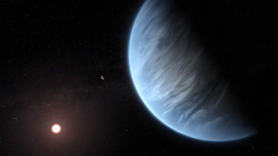 Rappresentazione artistica del pianeta K2-18 b, che ha vapore acqueo nell'atmosfera (fonte: ANSA / ESA / Hubble, M. Kornmesser)